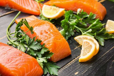 Tapeta Raw salmon fillet with herbs and lemon on table