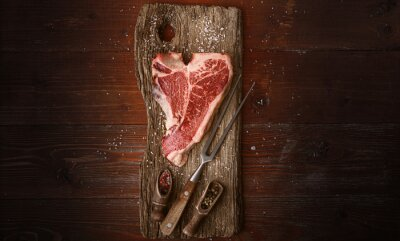 Tapeta raw tbone steak for blessing day and christmas holidays. A piece of fresh organic farm meat