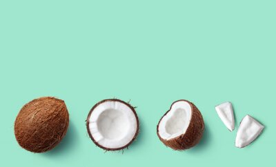 Row of fresh whole and half of coconut and slices