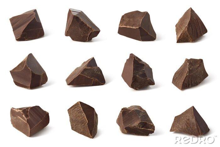 Tapeta Set of broken dark chocolate pieces