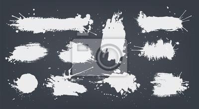 Tapeta set white ink spots set on black background.