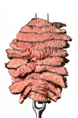 Tapeta slices of a steak on white background