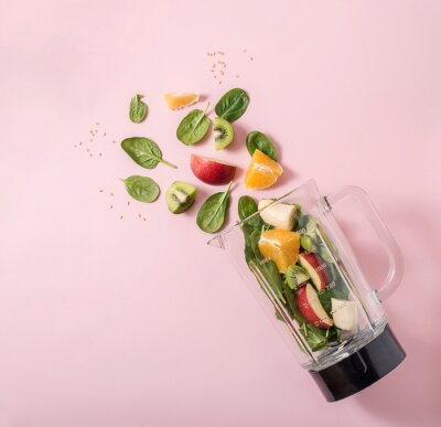 Tapeta Smoothie ingredients in mixer, smoothie preparation with spinach, apple, orange, kiwi, healthy eating, detox and nutritional consultation concept