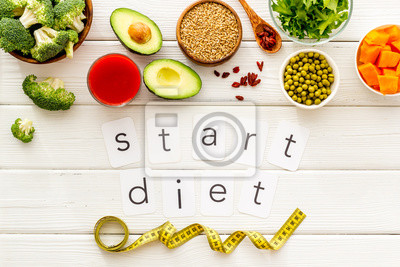 Tapeta Start diet text near healthy food on white wooden background top view
