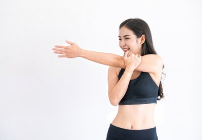 Tapeta Strong and confident Asian woman in fitness gym. Healthy lifestyle concept.