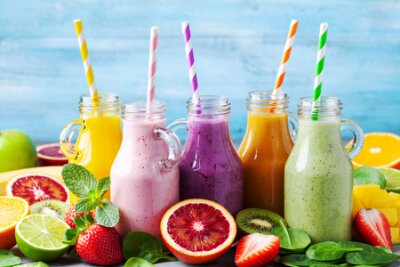 Tapeta Summer colorful fruit smoothies in jars with ingredients. Healthy, detox and diet food concept.