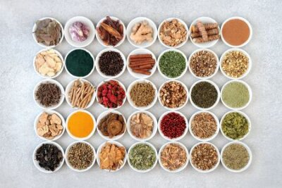 Tapeta Super food collection for health, fitness and vitality in porcelain bowls including dietary supplement powders and herbs and spice used in natural and chinese herbal medicine. Flat lay.