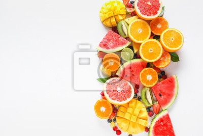Tapeta Sweet ripe fruits and berries on white background