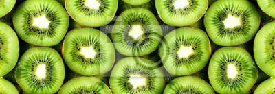 Tapeta Świeża organicznie kiwi owoc pokrajać. Rama żywności z miejsca kopiowania tekstu. Transparent. Zielony kiwi okrąża tło