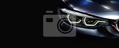 Tapeta Szczegóły na temat jednego z reflektorów LED nowoczesny samochód.