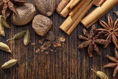Tapeta Various cooking spices, anise, cardamom, nutmeg, cinnamon on  brown table. Spices set.