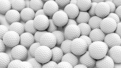 Tapeta Wiele piłek golfowych razem zbliżenie na białym