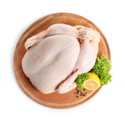 Tapeta Wooden board with raw turkey and ingredients on white background, top view