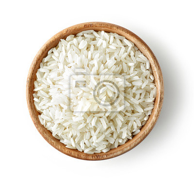 Tapeta wooden bowl of raw rice