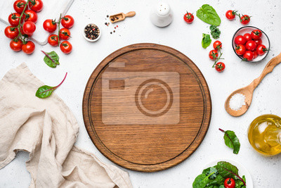 Tapeta Wooden pizza board and pizza cooking ingredients on white concrete background. Table top view. Copy space for text, recipe, restaurant or cafe menu