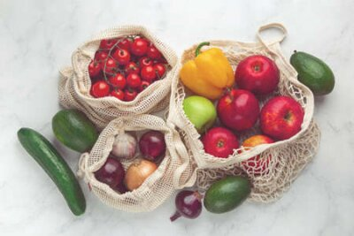 Tapeta Zero waste and eco-friendly concept. Fresh organic fruits and vegetables in reusable textile shopping bags. top view, toned